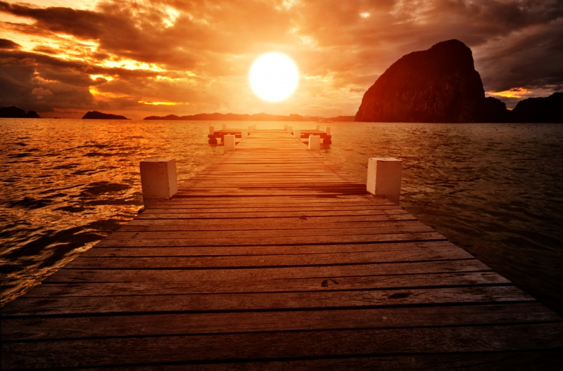 Fototapeta molo při západu slunce